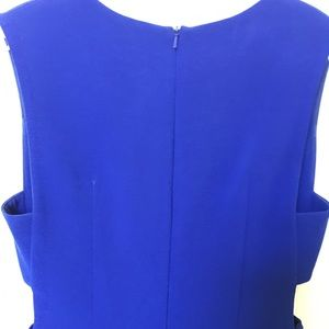Clove Blue Dress with tasteful cut-outs at ribs.